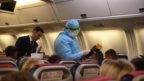Коронавирус проверка в самолете